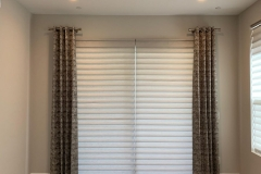 Custom-grommet-drapery-panels-with-Hunter-Douglas-Vignette-tiered-Roman-shades.-2